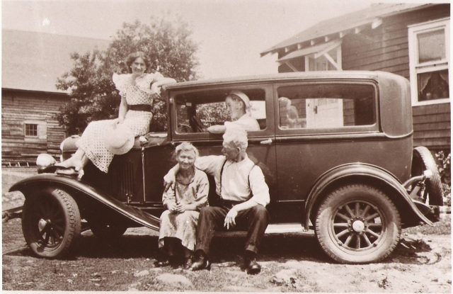 Jopseph and Sophia Mirota with two of their children, taken at the back of their house. Copyright 2016 Genealogy Sisters