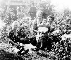 Zofia and friends in the flower garden. Copyright 2103 Genealogy Sisters