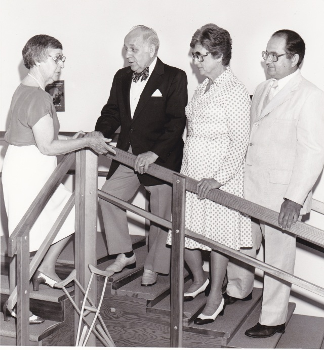 """August 16, 1985. """"Evelyn Barnes, R.N., left, director of the Somerset Crippled Children's Treatment Center, Bridgewater, explains uses for a set of steps in the therapy room to (Left to right) Freeholder Vernon Noble, county human services chairman; Edith Regan, R.N., coordinator of community-based services for the N.J. Department of Health, special child health services; and John A. Koopman, chairman of the center board of directors. The treatment center, a nonprofit organization run by Elks lodges, hosts the Somerset County Special Child Health Services Case management Unit."""""""