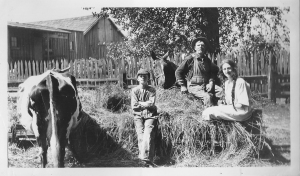 Gus Olson with Philip and Ester on the farm. Photo courtesy of C. Cunningham.