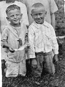 Joe Mirota (kneeling, right front) with friend. Circa 1922.