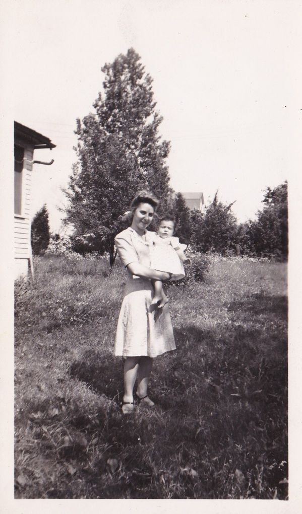 July 2, 1944. Carol is being held by an unknown woman.