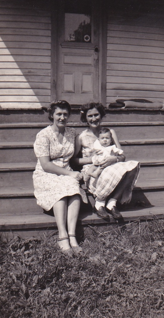July 2, 1944 - Mary Mirota is holding baby Carol. The other women is unknown.