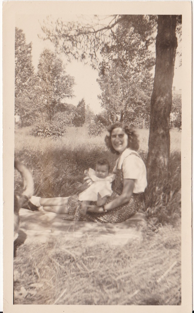 """June - 1944. Carol age - 8 months."" Baby Carol is held by Mary Mirota."