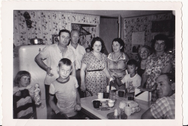 The adults in this picture were either born in Poland, or their parents were:  Joe Mirota is sitting on the right, and then going from left to right are: Jean Pucilowski Mirota, the Pani Smek and Pani Rozenek , Steve Mirota, Ted Lubas.
