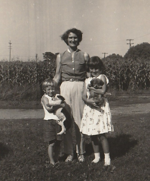 Taken around 1960 - Hunterdon County, New Jersey. With Mom and Sis, loving puppies. Copyright 2015 Genealogy Sisters.
