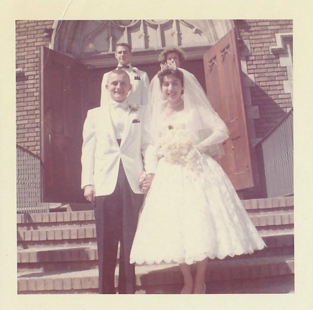 Victor and Bettyann Mirota on the steps of St. John's Catholic Church.